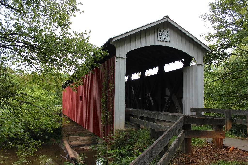 The red and white Harra Covered Bridge near Marietta, Ohio.