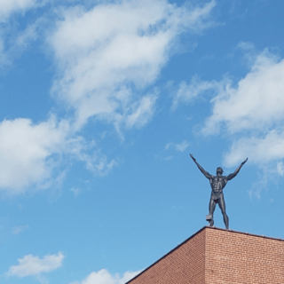 The Native American Indian stands on the roof of the Alan Cottrill Gallery.