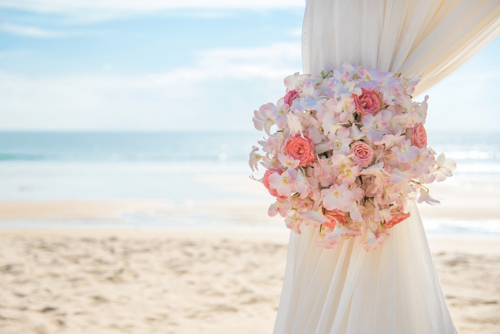 The view of the water and sand at a beach wedding.