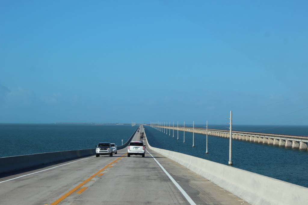 A bridge stretching over the ocean on both sides leading to the Florida Keys.