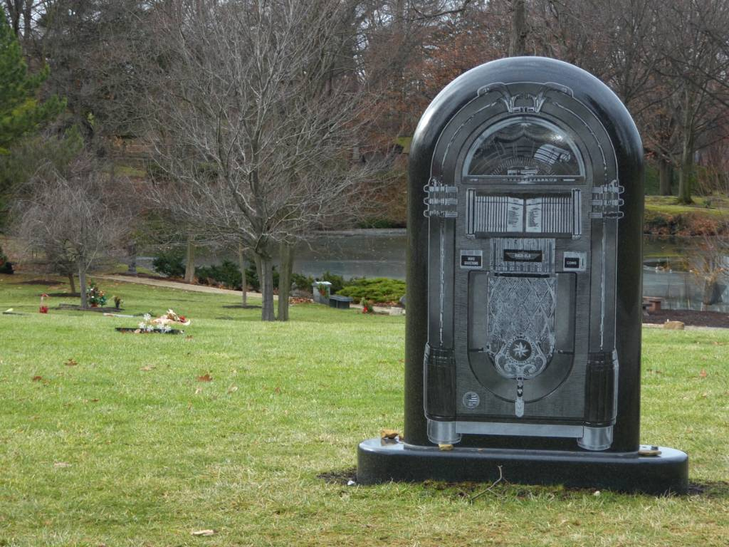 A gravestone that looks like a jukebox.