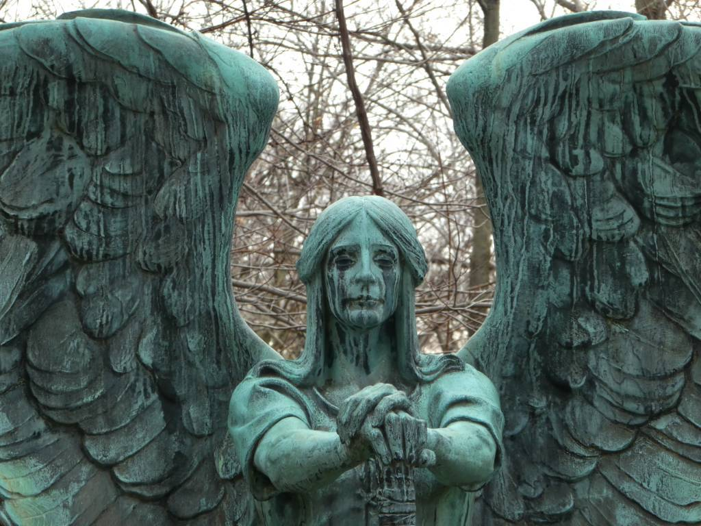 A cemetery monument of an angel crying black tears.