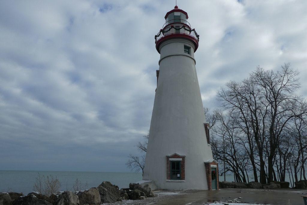 The Marblehead Lighthouse against a snowy sky.