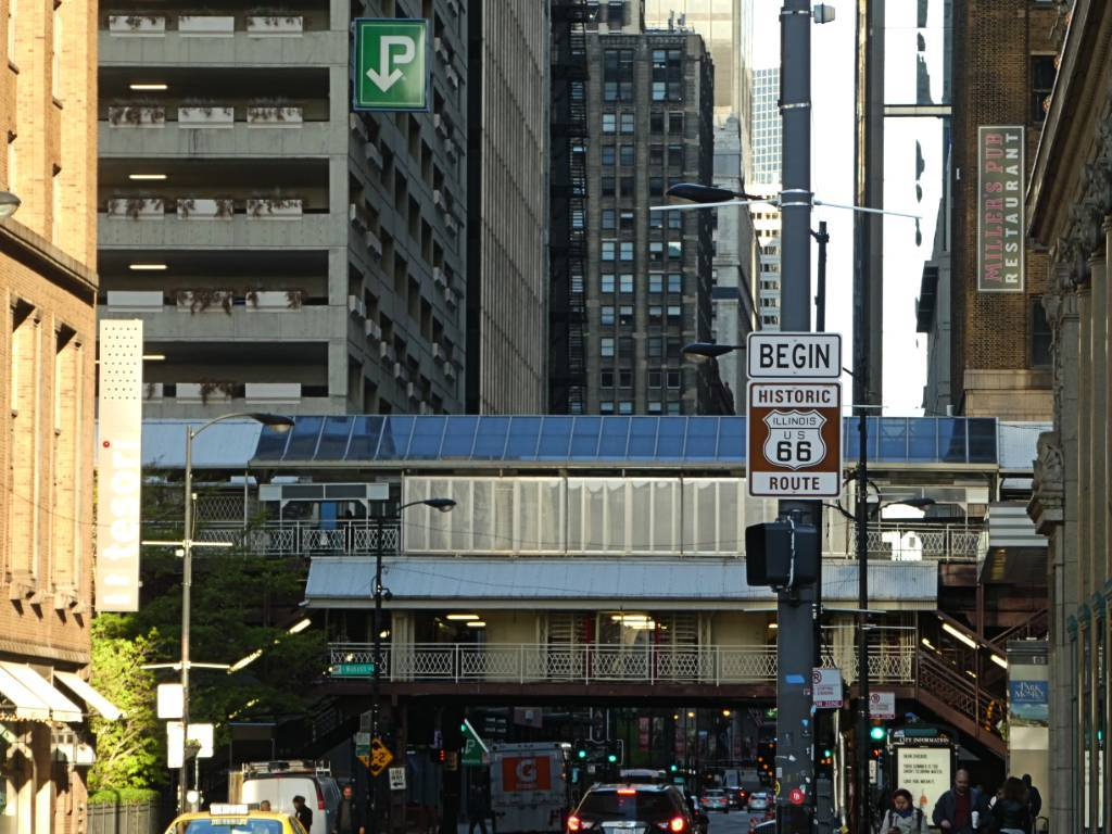 A busy street in Chicago is where you'll find the road sign announcing the beginning of Route 66.