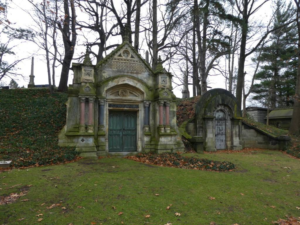 An ornate mausoleum in a cemetery