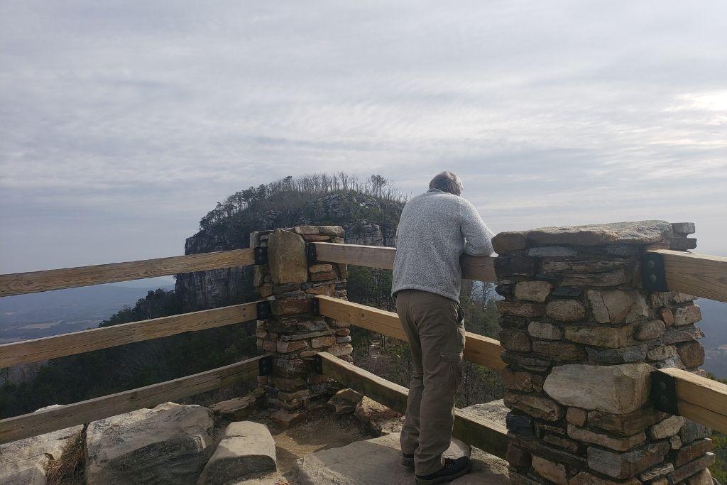A man admiring the view of Big Pinnacle