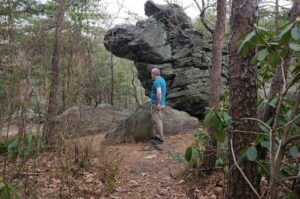 Giant rocks tower over visitors along this paved trail at Hanging Rock State Park in North Carolina.