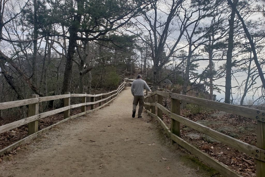 A man Walking to the Overlook to see Big Pinnacle