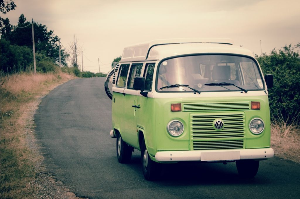 A pale green VW Camper Van