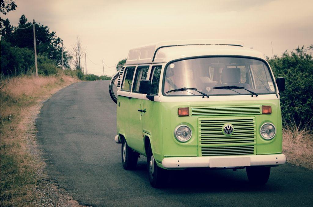 A pale green VW Camper Van