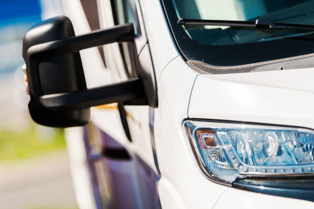 The rear view mirror of a camper van