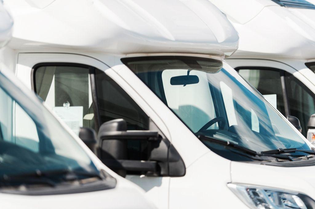 a row of used camper vans
