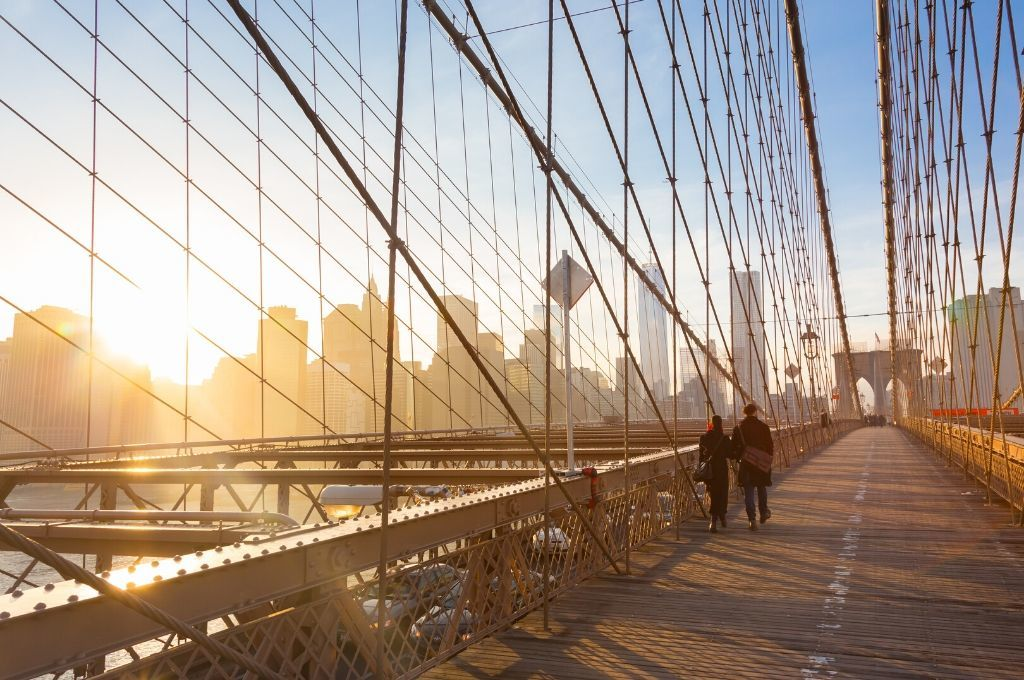 A sunset walk across the Brooklyn Bridge is very romantic