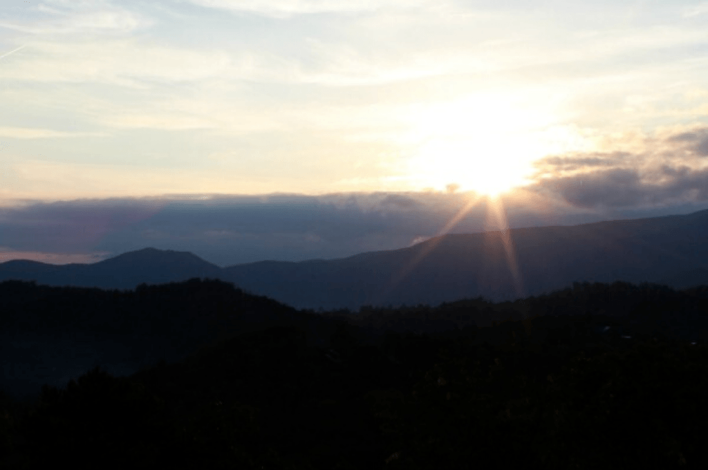 The sun is rising over the Smoky Mountains in Gatlinburg