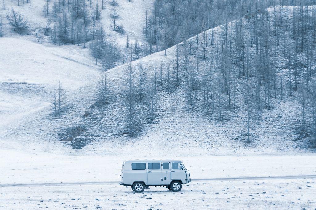 A camper van in a snowy scene.