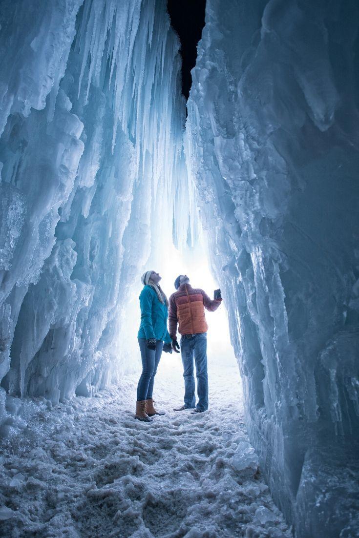 A couple walking through an Ice Castle