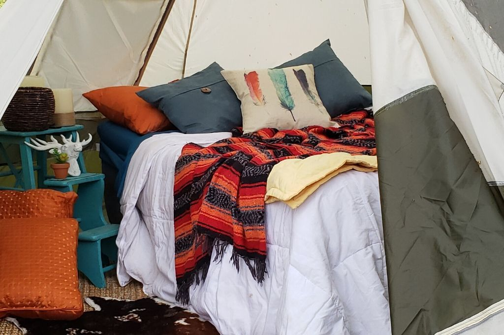 Glamping in a teepee shaped tent.