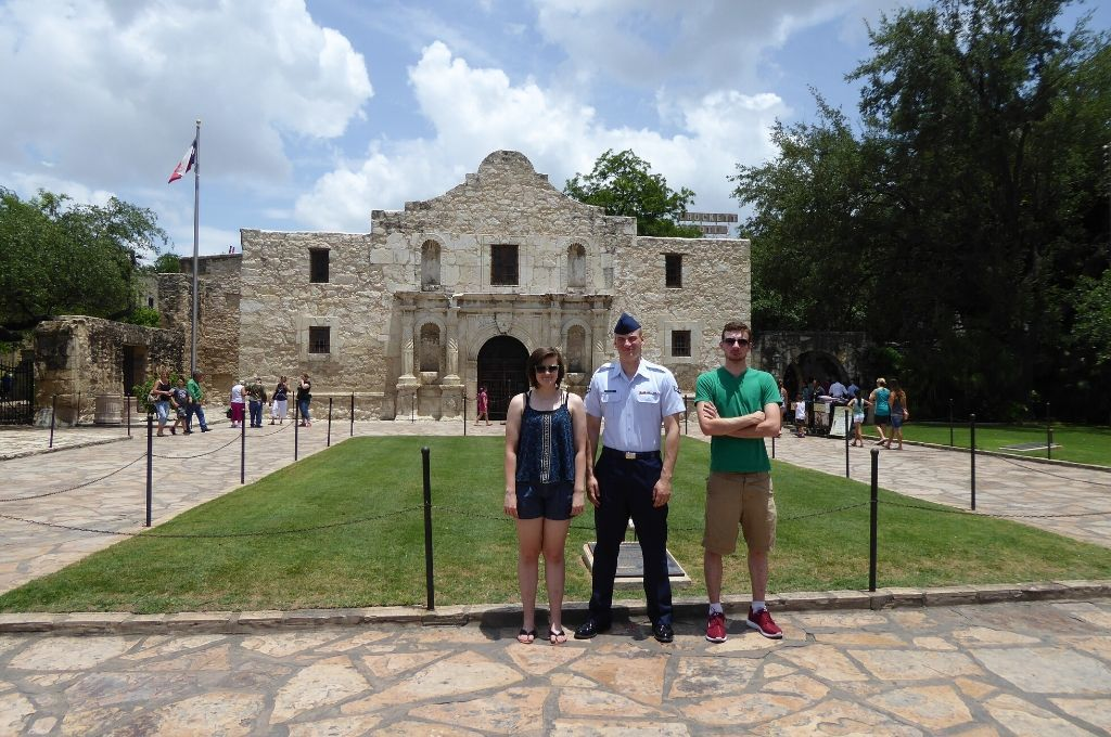 Standing outside the Alamo for photos