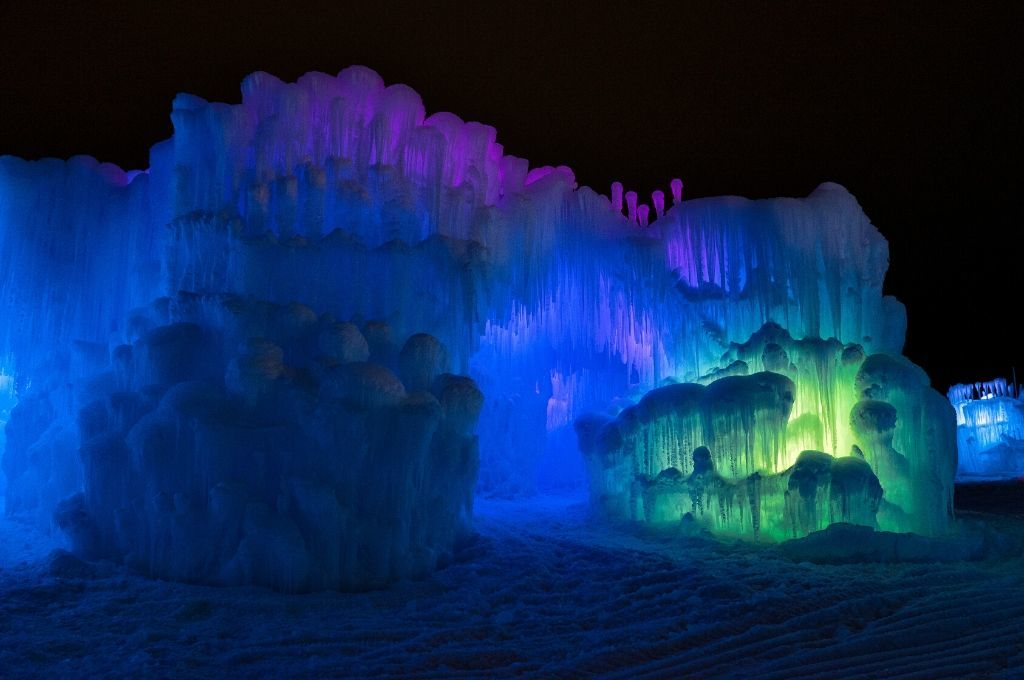 Ice castles are beautiful at night when lit up.