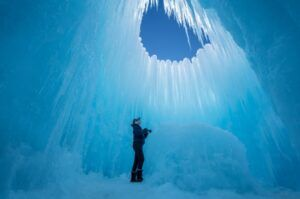 Light streams into the inside of an ice castle