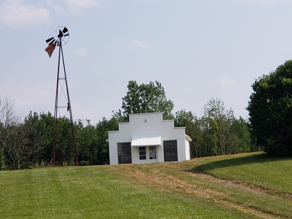 This vacant shop and windmill can be seen along the Lincoln Highway.