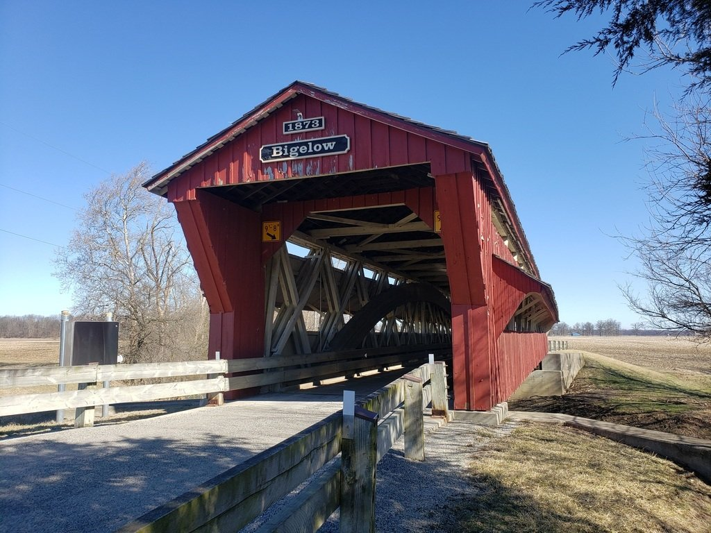 A barn red covered bridge can be seen along the Darby Plains Scenic Byway.