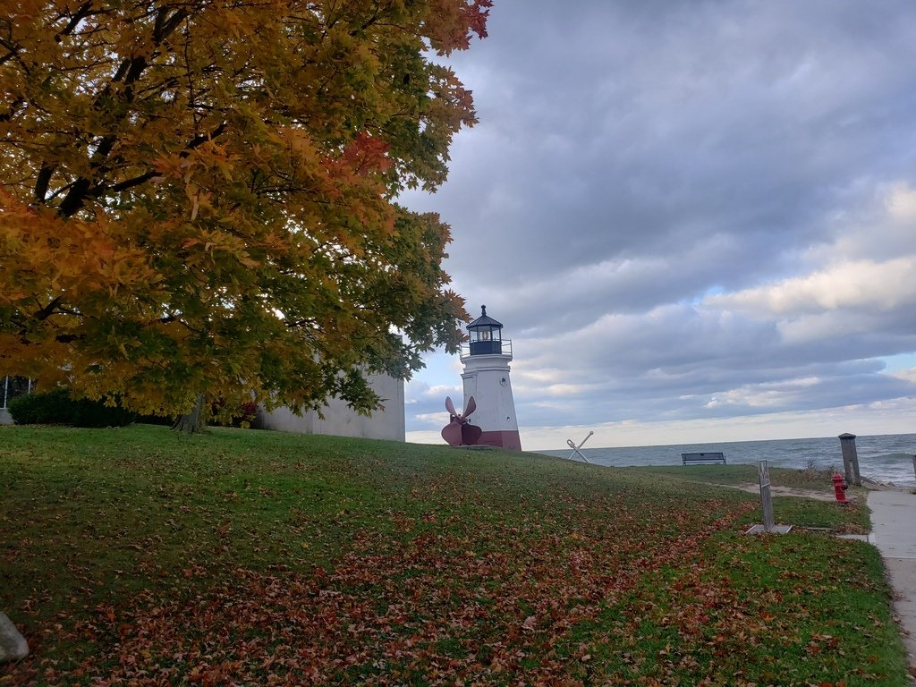 A lighthouse along Lake Erie in the fall.