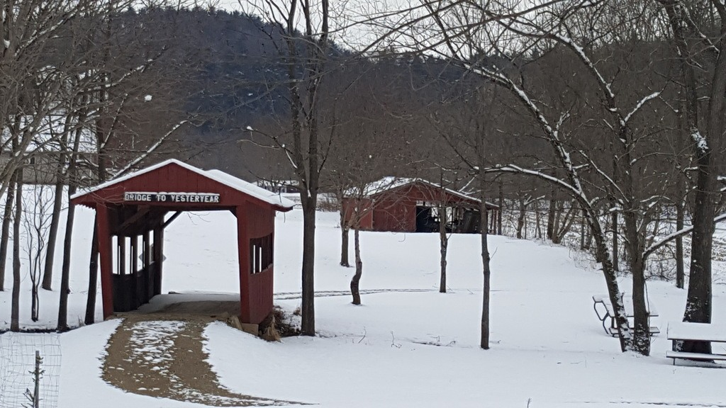 A covered bridge along the Wally Road Scenic Byway in Loudonville during the winter