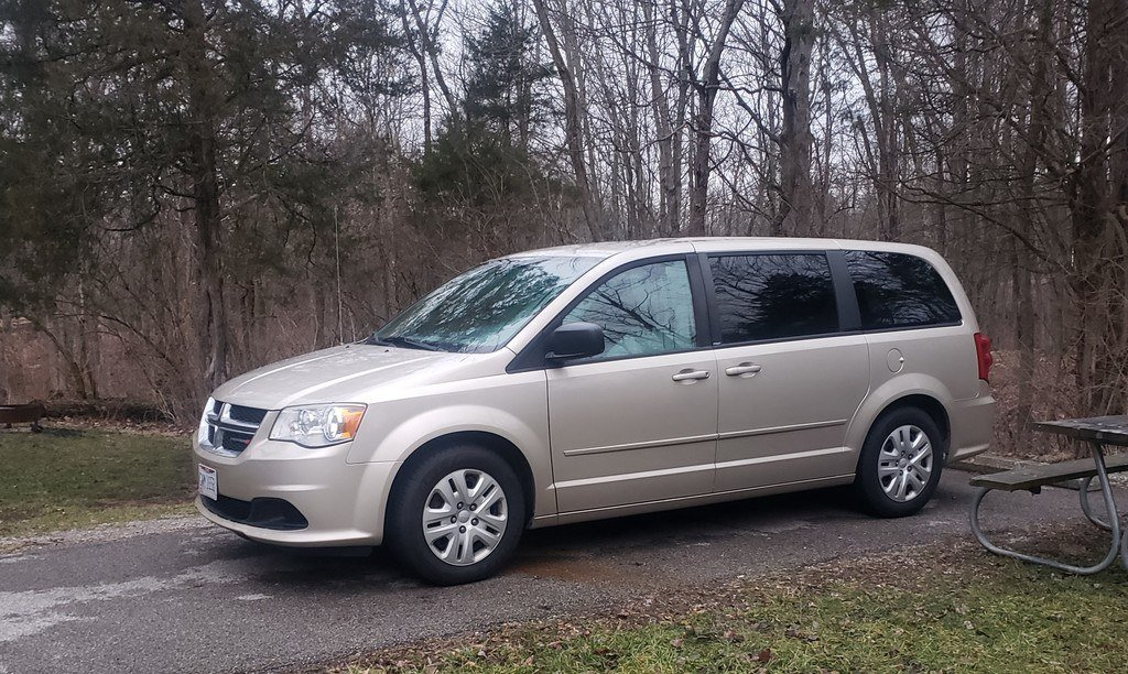 a minivan in a camping spot