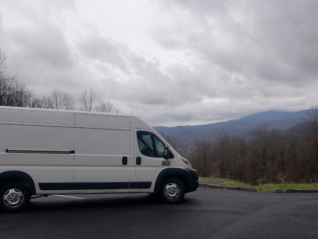 White van with mountains in the background