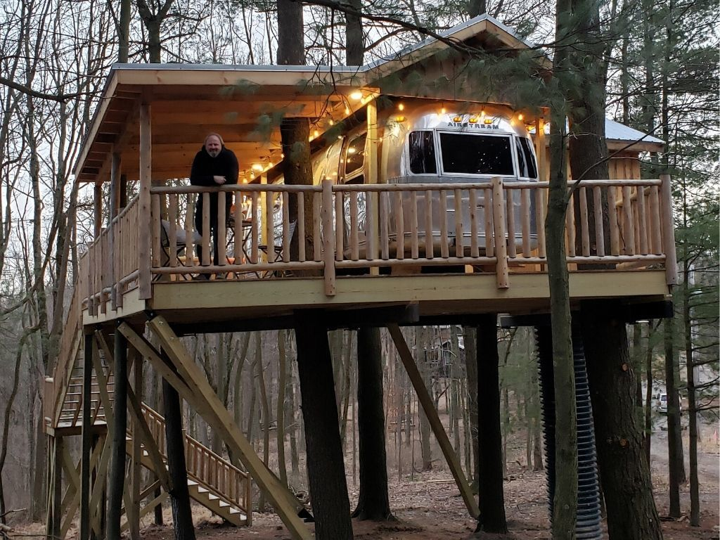 Enjoy a romantic unplugged treehouse getaway in the Silver Bullet.