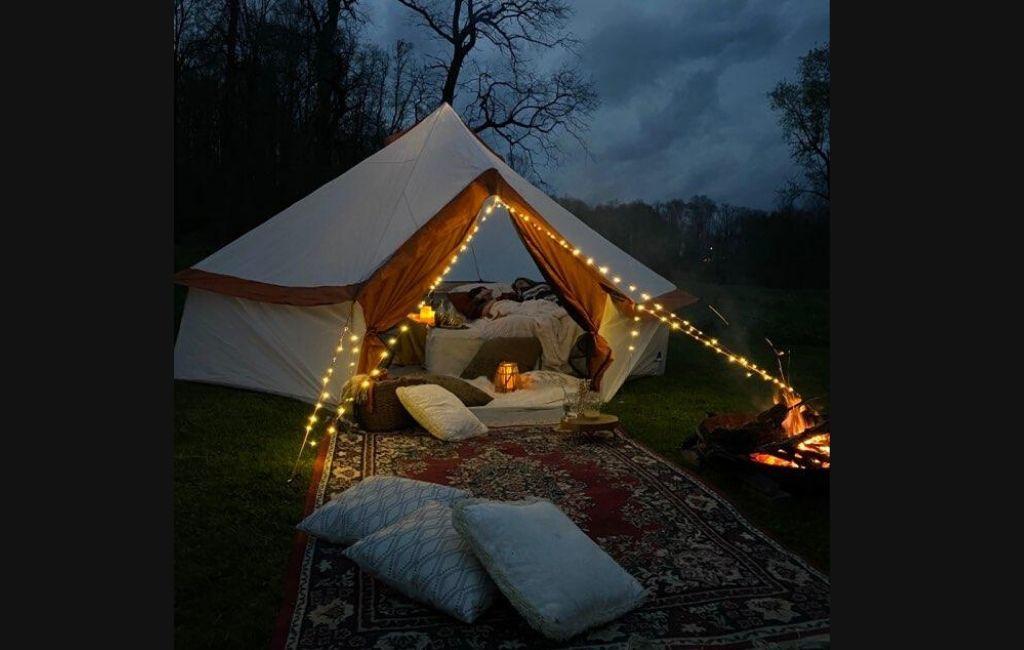 A yurt tent set up at night.