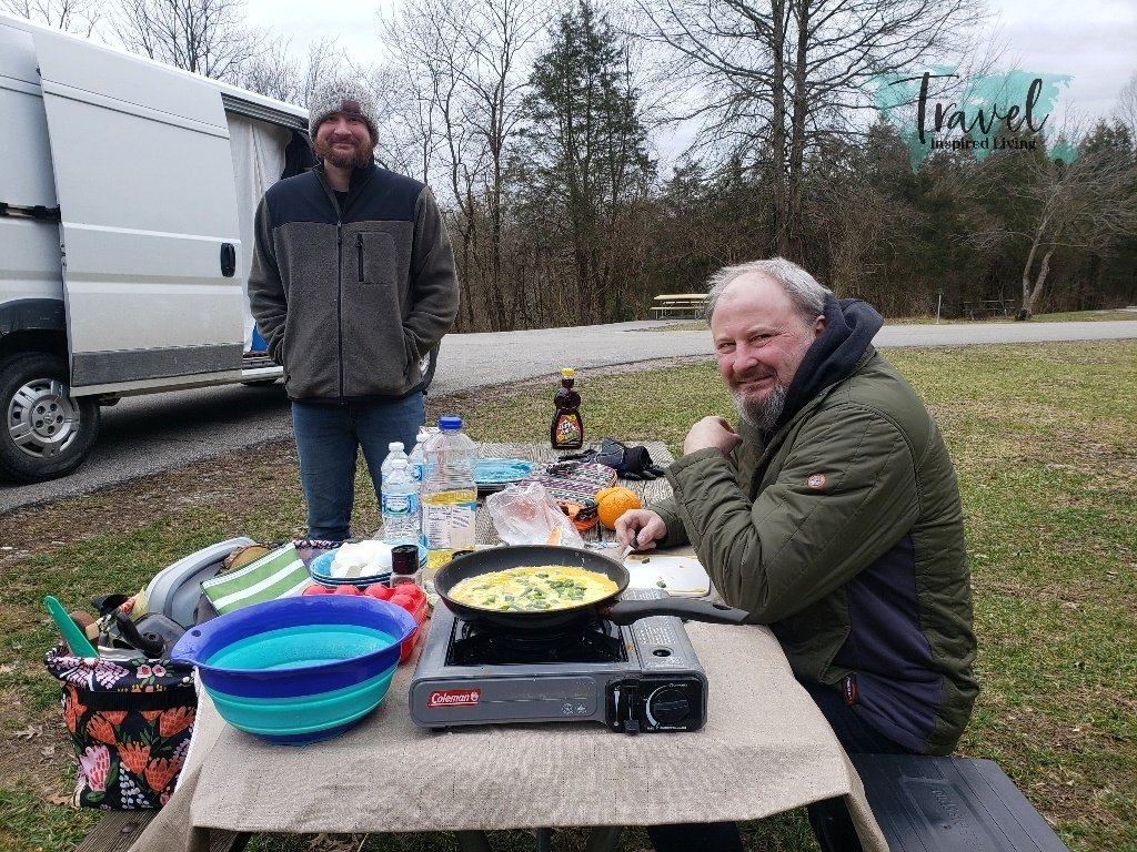 Eating breakfast outdoors at the campground while van camping.