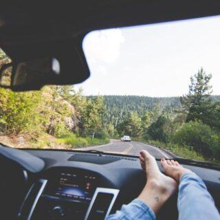 Road Tripping along a scenic route with your feet up.