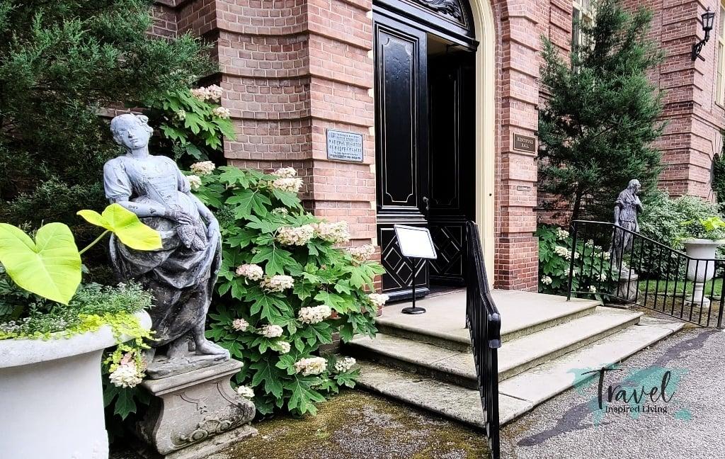 Sculptures flanking the front door
