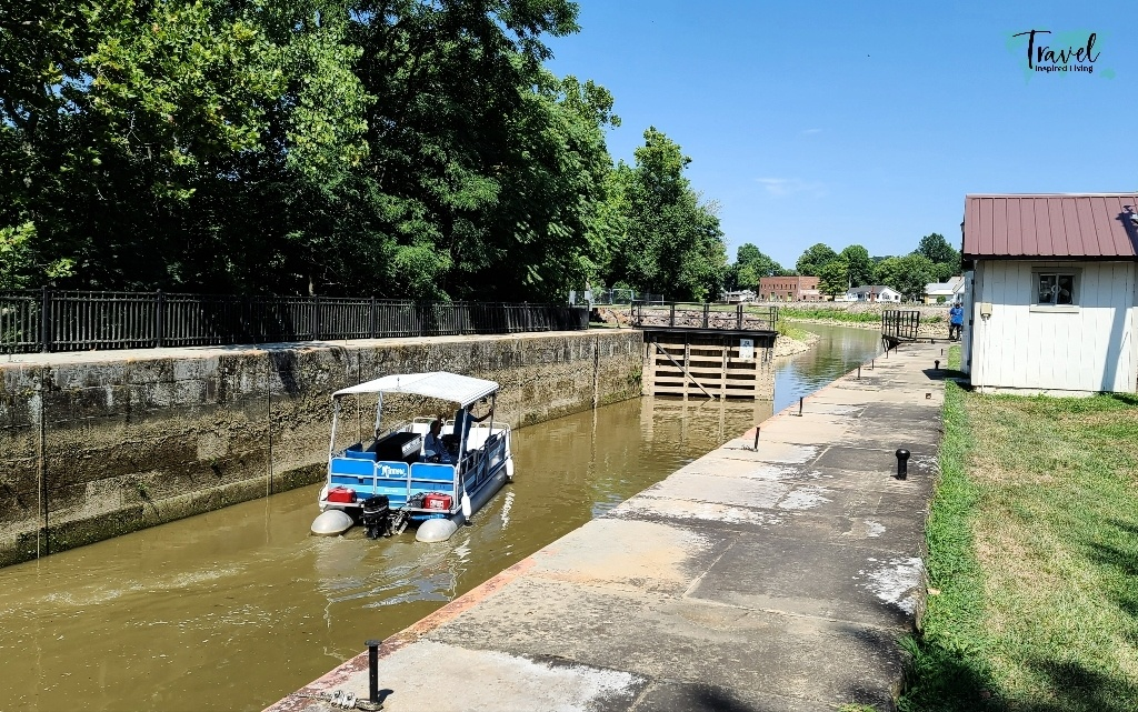 A boat going through a hand-cranked lock in southeastern Ohio.