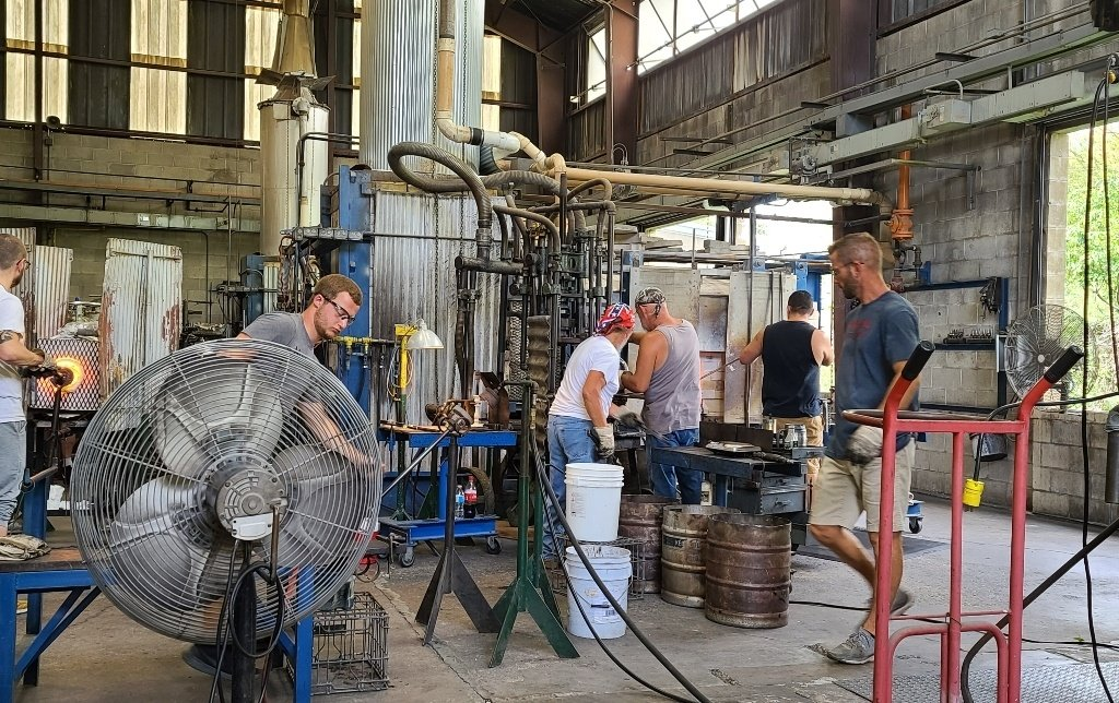 Men working in a glass factoryr