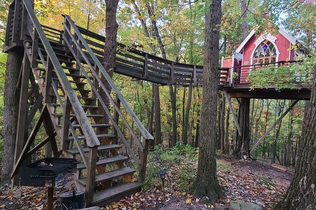 A red treehouse in the woods