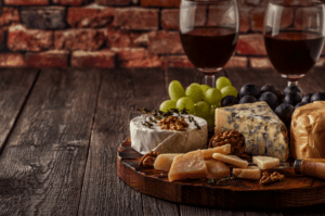 A beautifully prepared charcuterie with two glasses of wine are ideal for a treehouse meal.
