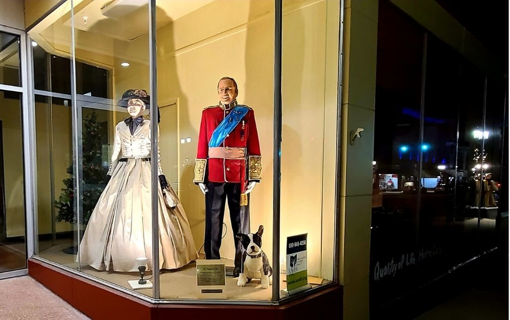 The royal family in a classic store front window.