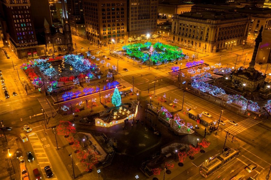 An aerial view of downtown Cleveland lit up with Christmas lights.
