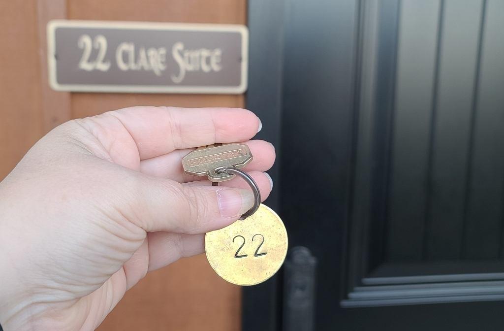 A room key to unlock the door to your hotel room. .