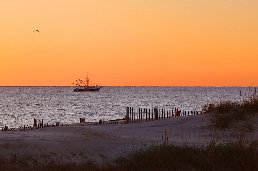 Watch the sunrise over the ocean during an Outer Banks getaway.