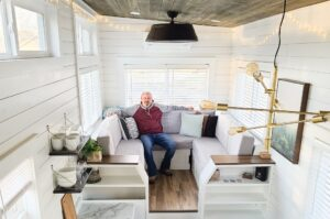 A man relaxing in the tiny house.