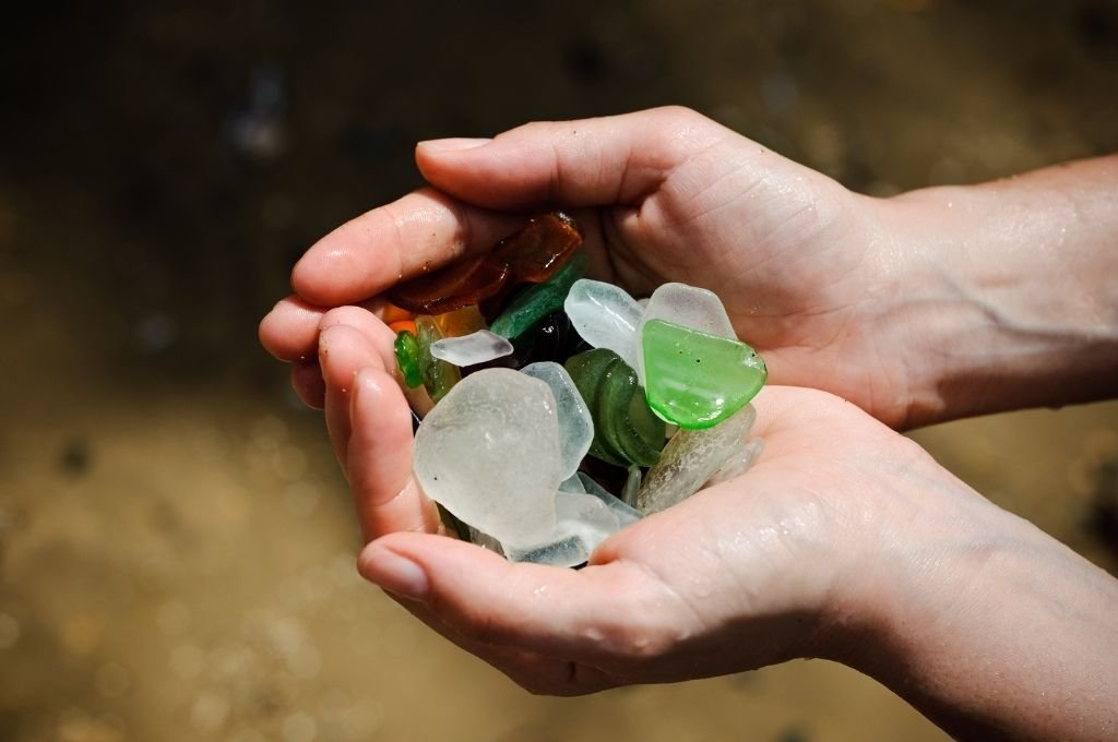 Holding a handful of beach glass