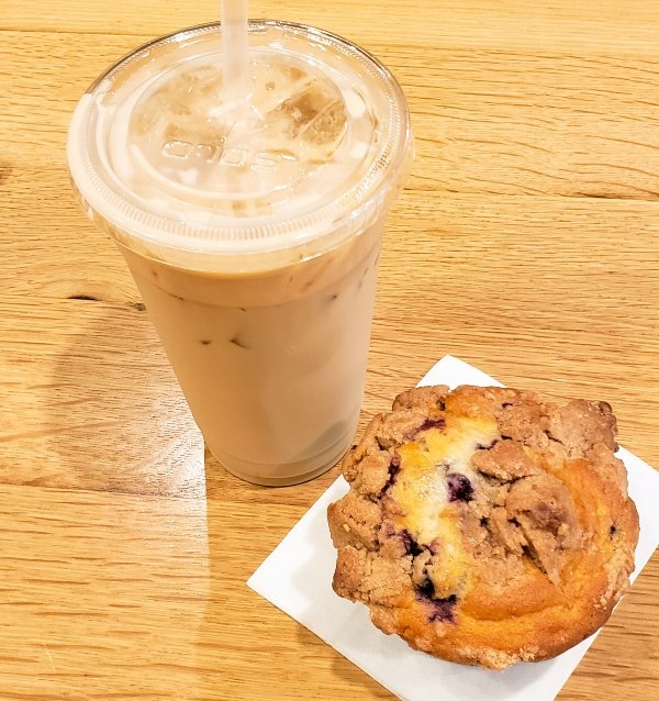 An iced coffee and blueberry muffin