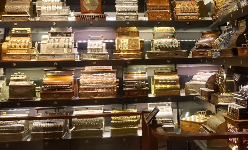 Antique cash registers line the walls in this collection of the world's largest cash registers in Dayton, Ohio.