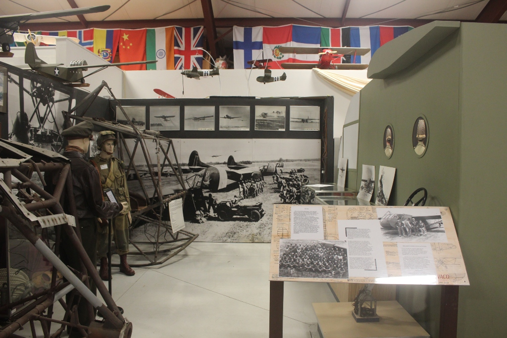 A peek inside the WACO Air Museum at the WWII exhibit which shows a WACO glider.