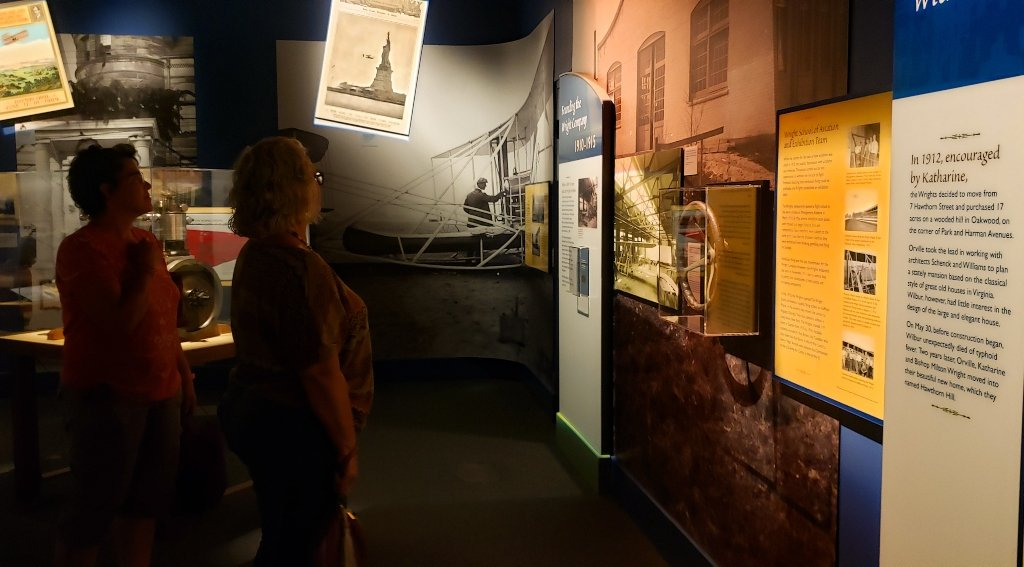 Two women viewing museum exhibits.