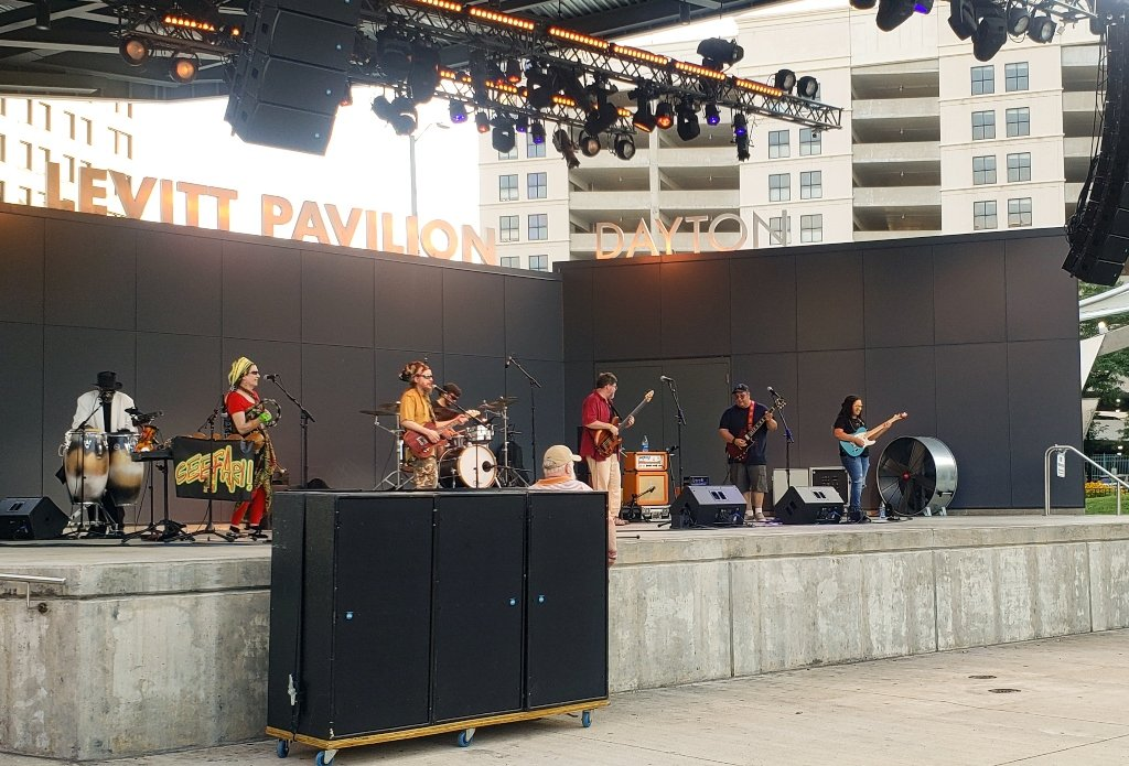 A band performing at an outdoor pavilion.